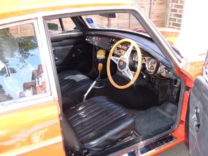 My 1970 MGB GT. Leather seats, a wooden steering wheel and gearknob, but otherwise fairly standard. Don't mind Hommer, he's good for clearing the windscreen when it mists up!For more pics see my website, which is linked from the links page.
