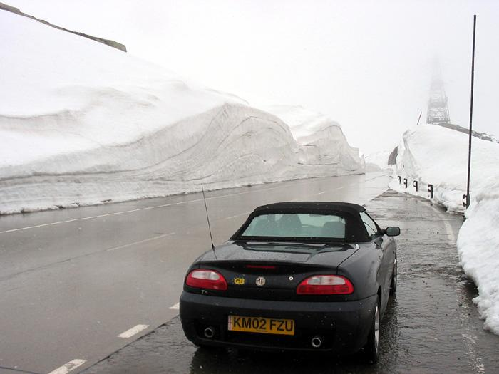 A picture of our TF at 8000ft last june up the gotthard pass,switzerland