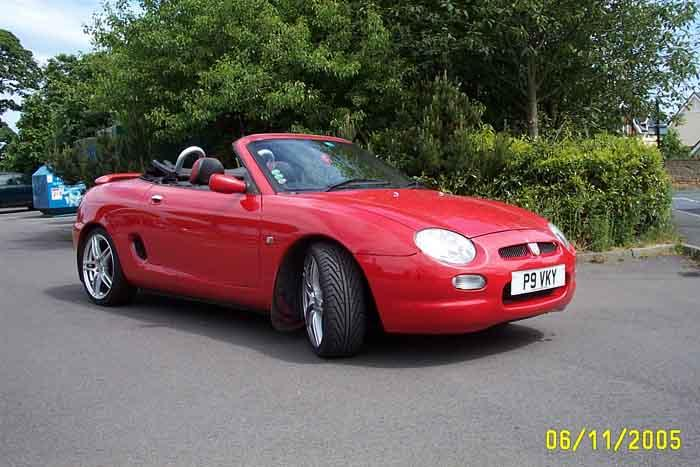 My beloved MGF.  I have spent a lot of time and money personalising my dream car.  This is the last photo before it is sold and my twins arrive!  Goodbye!