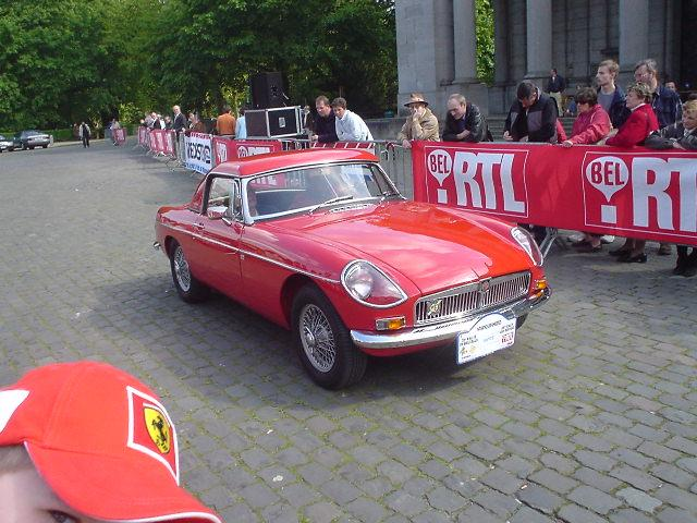 "MGB ""Jacques Coune"" at Brussels Classic car rally in May 2005. Sorry about the FERRARI hat : same colour but car is nicer."