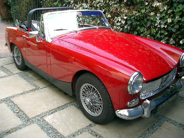 Proud New Member owning a 1968 Red MG Midget