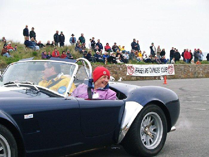Peter De Rousset-Hall from Surrey in his AC Cobra, burning rubber with Dizzy as passenger.The car is the last ever genuine AC Cobra to be built. It will be here again next year for the Silver Jubilee.