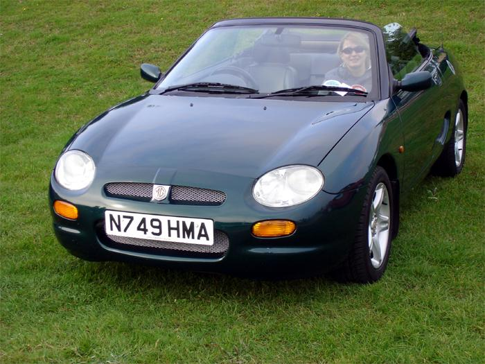 My British Racing Green MGF with tolerant and supportive girlfriend in passenger seat!