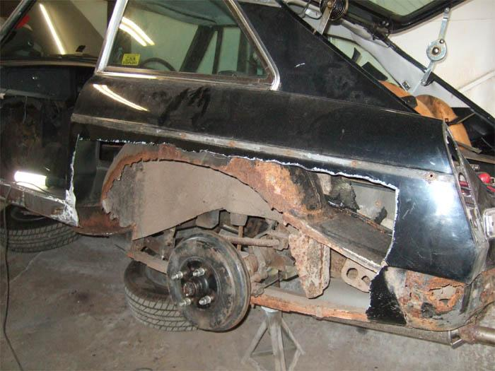 One of the back wheel arches removed