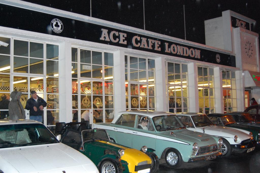 A small group of car's outside the Ace Cafe on a wet night in Febuary 07