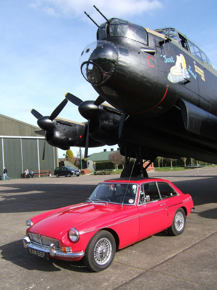 1967 MGB GT 'Kamilla' with Avro Lancaster NX611 'Just Jane' at the Lincolnshire Aviation Heritage Centre, East Kirby