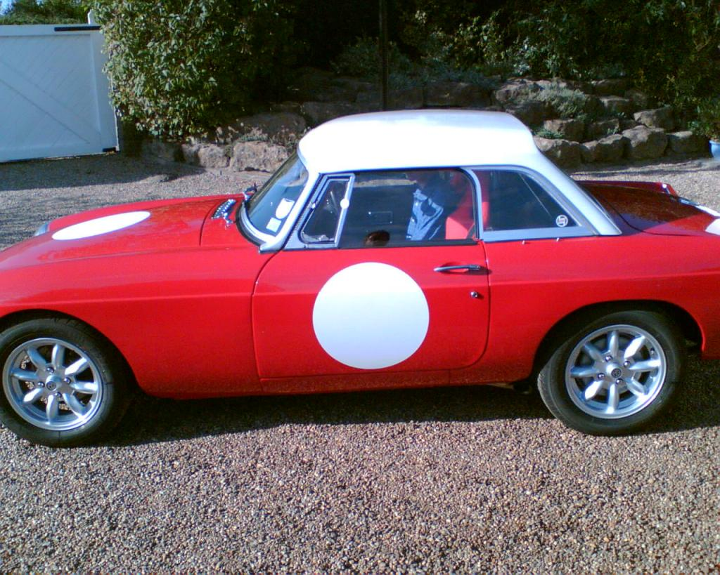 "My 1971 B-roadster was tired and worn out in 2003. Following £10K+ renovation by AJ Restorations this is the 2007 image. Tasteful bodywork (perfect panel gaps), no chrome, sebring fr&rear, bespoke rollcage, works hardtop, susp.  & brake tweeks, 1840 Oselli based engine, Weber, side exhaust,  15"" minilites - no am not racing it - just posing!!"