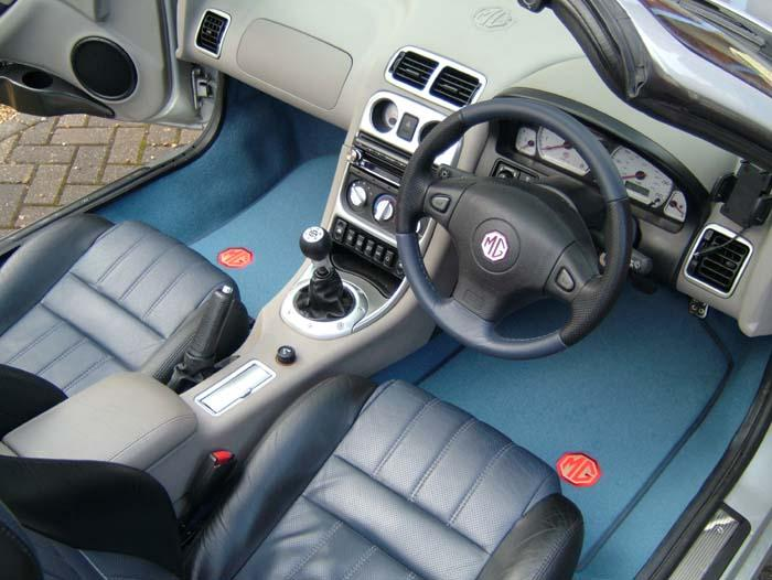 New carpets, Steering wheel and Chrome instrument surrounds.