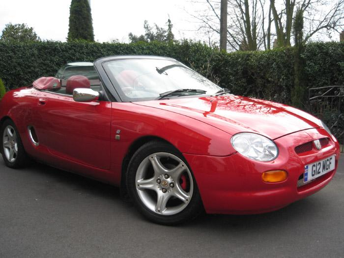 Flame red MGF which I've had for 8yrs and still looking good. More money spent than it cost to buy!! hehe