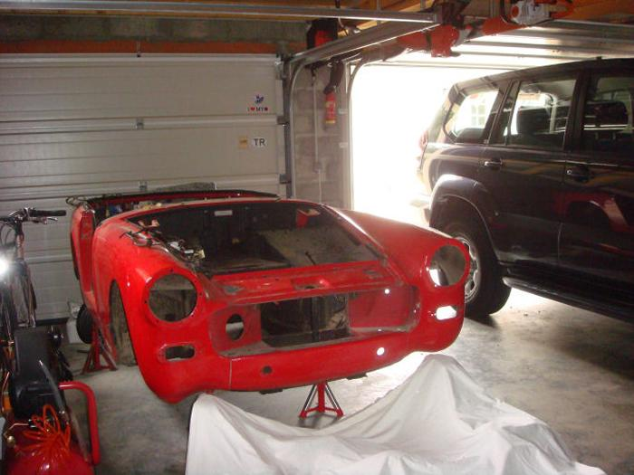 Midget stripped from of all it's components, to be replaced by a new body shell.