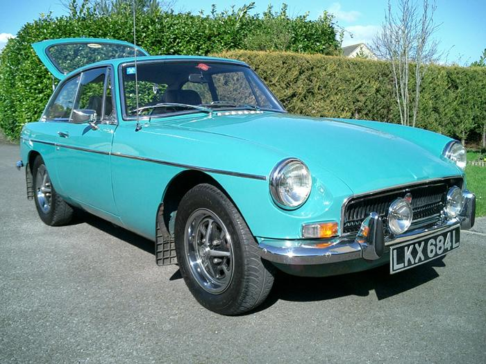 This is a 1972 car, the only year that Aqua was available on the MGB models. It certainly is a refreshing change from the standard colours. This one is in nice condition and has won many awards.