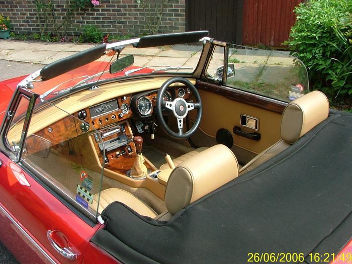 Tan and walnut interior.