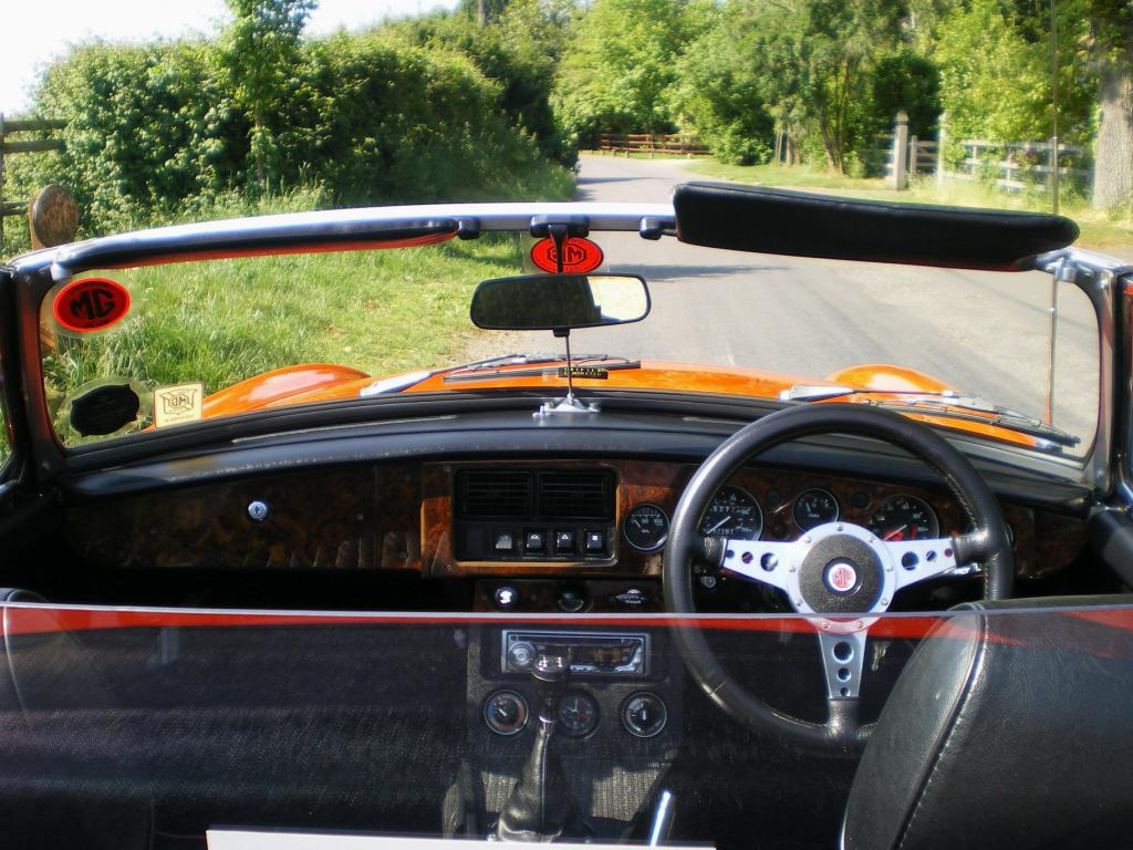 a country lane sitting behind the dash of a 'b'