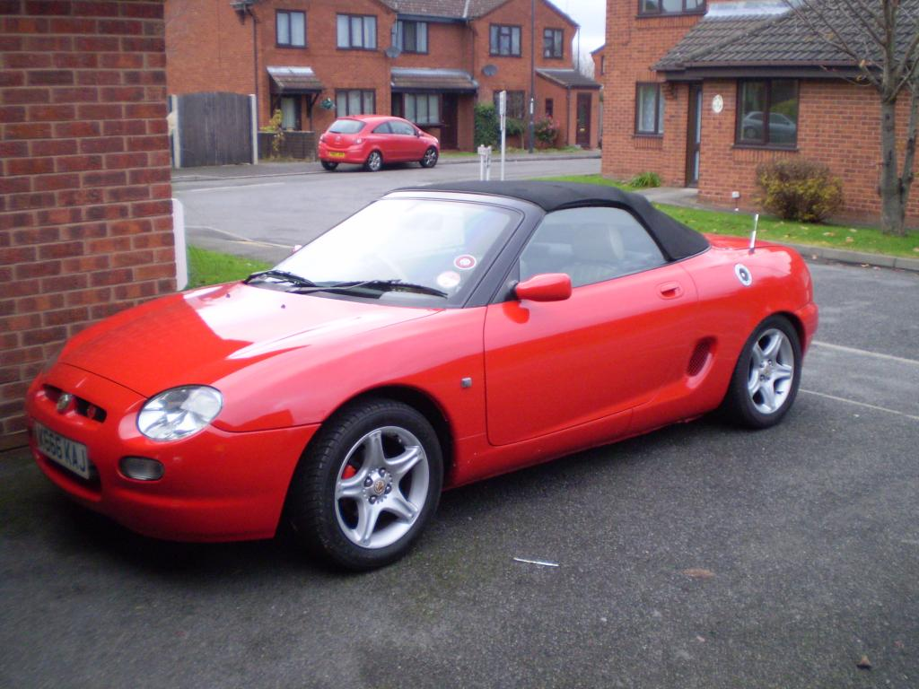 Our newly repaint mgf, by my own hand..bright red..looks beautiful.