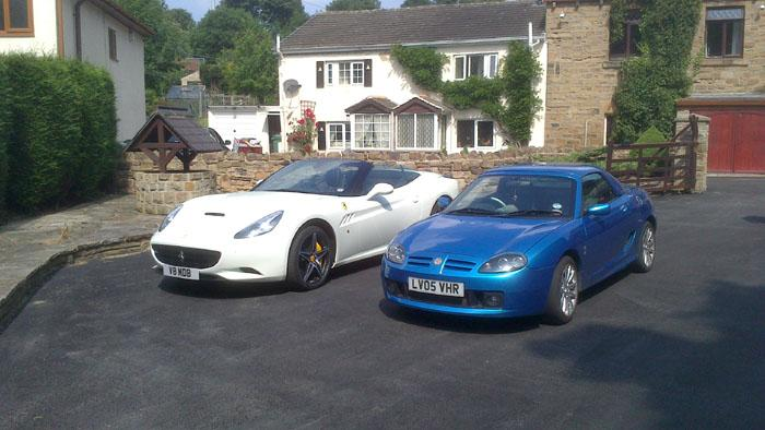 My neighbour borrowed his brothers Ferrari and took me for  a spin. I had to take a photo of them side by side.