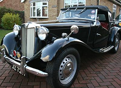 Our MG TD that we purchased to replace our ealier Austin 7 RN Box Saloon