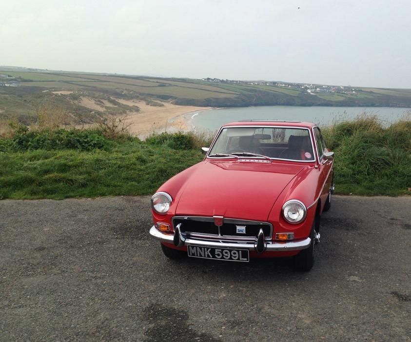 My MGB GT overlooking Crantock beach, Cornwall.